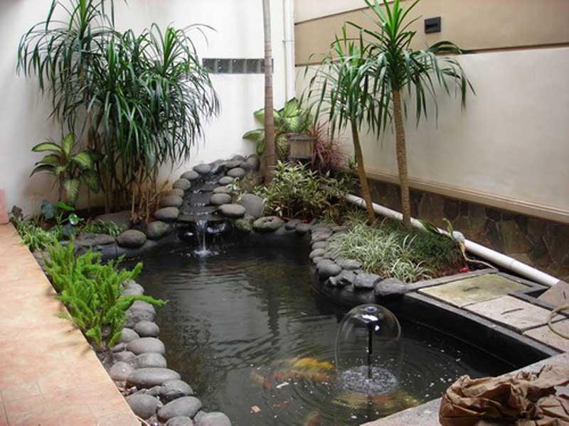 Taman Depan Rumah Minimalis Modern Alami Dengan Khas Bebatuan